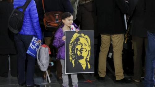 A supporter holds a sign with the likeness of U.S. presidential candidate and former Secretary of State Hillary Clinton before a rally as she campaigns for the 2016 Democratic presidential nomination in New York March 2, 2016. REUTERS/Lucas Jackson