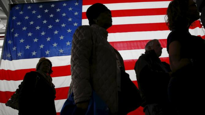 Supporters walk past a large flag as they arrive for an event with U.S. presidential candidate and former Secretary of State Hillary Clinton as she campaigns for the 2016 Democratic presidential nomination in New York March 2, 2016. REUTERS/Lucas Jackson