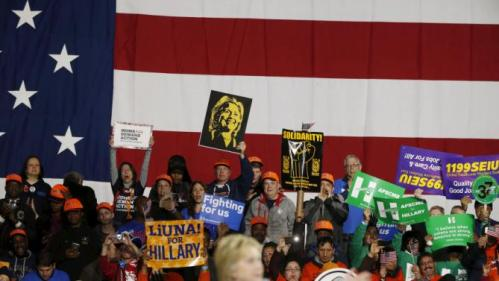 A supporter holds a sign with the likeness of Democratic U.S. presidential candidate Hillary Clinton as she addresses a 'Hillary for America' rally in New York March 2, 2016. REUTERS/Lucas Jackson