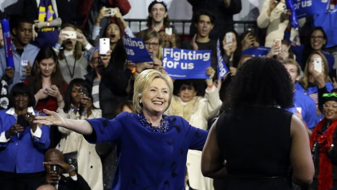 Democratic presidential candidate Hillary Clinton, left, greets Aleatha Williams before speaking during a rally, Wednesday, March 2, 2016, in New York. (AP Photo/Julie Jacobson)