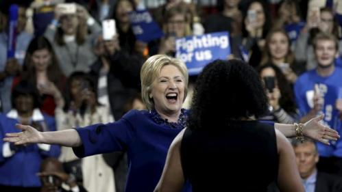U.S. Democratic presidential candidate Hillary Clinton greets Alethea Williams as she takes the stage to speak to supporters at a campaign event in the Manhattan borough of New York City, March 2, 2016. REUTERS/Mike Segar