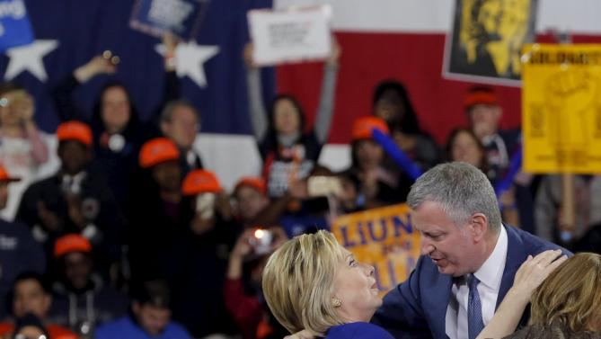 Democratic U.S. presidential candidate and former Secretary of State Hillary Clinton greets New York Mayor Bill de Blasio after a Hillary for America rally in New York March 2, 2016. REUTERS/Lucas Jackson