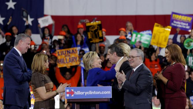 Democratic U.S. presidential candidate and former Secretary of State Hillary Clinton greets New York Governor Andrew Cuomo after a Hillary for America rally in New York March 2, 2016. REUTERS/Lucas Jackson