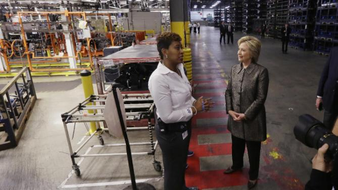 Democratic presidential candidate, Hillary Clinton speaks with Deanne Austin at the Detroit Manufacturing Systems plant, Friday, March 4, 2016, in Detroit. (AP Photo/Carlos Osorio)