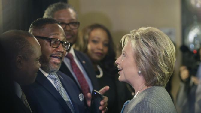 Democratic presidential candidate, Hillary Clinton meets with The Rev. Kenneth J. Flowers of the Greater New Mt. Moriah Missionary Baptist Church before speaking with African American ministers, Saturday, March 5, 2016, in Detroit. (AP Photo/Carlos Osorio)