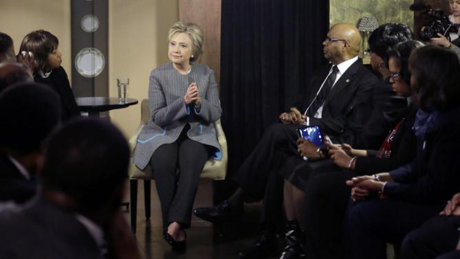 Democratic presidential candidate Hillary Clinton speaks with African American ministers, Saturday, March 5, 2016, in Detroit. (AP Photo/Carlos Osorio)