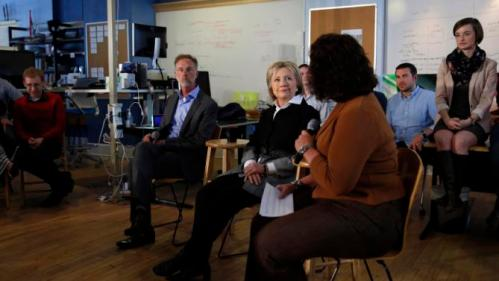 U.S. Democratic presidential candidate Hillary Clinton listens during a campaign stop at Atomic Object company in Grand Rapids, Michigan, March 7, 2016. REUTERS/Carlos Barria
