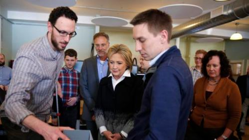 U.S. Democratic presidential candidate Hillary Clinton talks to employees as she visits Atomic Object company during a campaign stop in Grand Rapids, Michigan, March 7, 2016. REUTERS/Carlos Barria