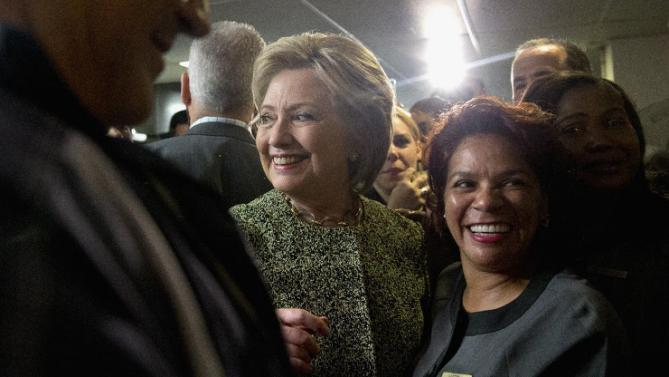 """Democratic presidential candidate Hillary Clinton greets employees at the Fontainebleau Hotel in Miami Beach, Thursday, March 10, 2016, before departing to the airport en route to Tampa for a """"Get Out the Vote"""" campaign event. (AP Photo/Carolyn Kaster)"""