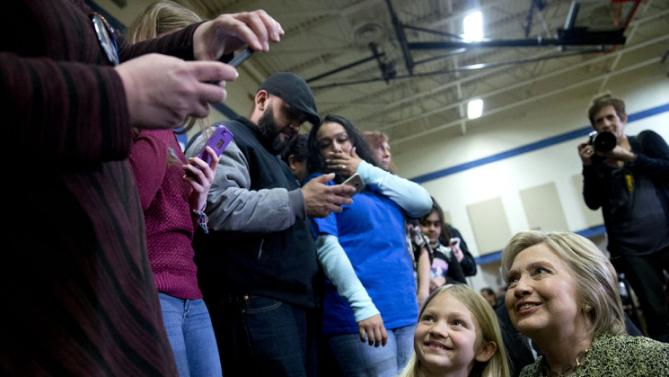 Democratic presidential candidate Hillary Clinton poses for a photo with a young girl  during a campaign event at Sullivan Community Center and Family Aquatic Center in Vernon Hills, Ill., Thursday, March 10, 2016. (AP Photo/Carolyn Kaster)