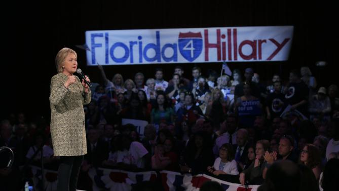Democratic U.S. presidential candidate Hillary Clinton speaks to supporters during a campaign rally in Tampa, Florida, March 10, 2016. REUTERS/Carlos Barria