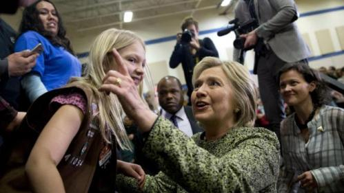 Democratic presidential candidate Hillary Clinton greets people in the audience during a campaign event at Sullivan Community Center and Family Aquatic Center in Vernon Hills, Ill., Thursday, March 10, 2016. (AP Photo/Carolyn Kaster)