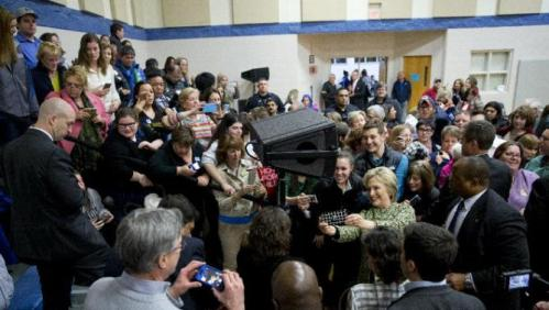 Democratic presidential candidate Hillary Clinton greets people in the crowd and posed for photographs during a campaign event at Sullivan Community Center and Family Aquatic Center in Vernon Hills, Ill., Thursday, March 10, 2016. (AP Photo/Carolyn Kaster)