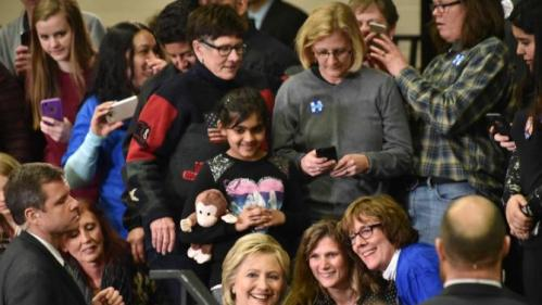 Democratic presidential candidate Hillary Clinton gets her photo taken with her supporters during a campaign event in Vernon Hills, Ill., Thursday, March 10, 2016. (John Starks/Daily Herald via AP) MANDATORY CREDIT