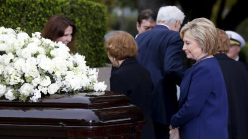 Former first lady Rosalynn Carter (C) greets Patti Davis as she and former first lady Hillary Clinton (R) pay their respects during the funeral for former first lady Nancy Reagan at the Ronald Reagan Presidential Library in Simi Valley, California March 11, 2016. REUTERS/Mike Blake