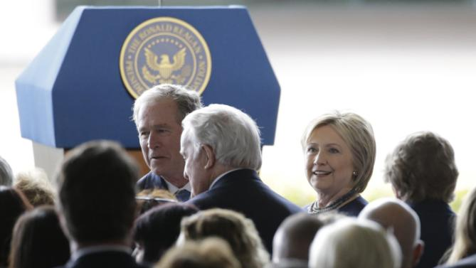 Former President George W. Bush, left, and Hillary Clinton arrive at the funeral service for Nancy Reagan at the Ronald Reagan Presidential Library, Friday, March 11, 2016 in Simi Valley, Calif. (AP Photo/Jae C. Hong)