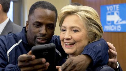 Democratic presidential candidate Hillary Clinton poses for a photo with with a member of the audience after speaking at the the O'Fallon Park Recreation Complex in St. Louis, Saturday, March 12, 2016. (AP Photo/Carolyn Kaster)