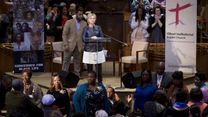 Mothers who have lost children to gun violence stand as they are acknowledged during Democratic presidential candidate Hillary Clinton's town hall meeting at Olivet Institutional Baptist Church in Cleveland, Saturday, March 12, 2016. (AP Photo/Carolyn Kaster)