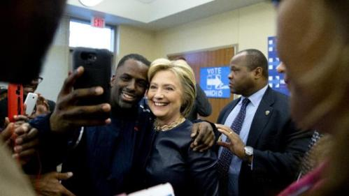 Democratic presidential candidate Hillary Clinton poses for photos with supporters after speaking at the the O'Fallon Park Recreation Complex in St. Louis, Saturday, March 12, 2016. (AP Photo/Carolyn Kaster)