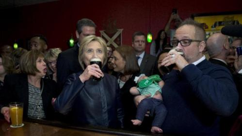 Democratic presidential candidate Hillary Clinton has a Guinness at the packed O'Donold's Irish Pub and Grill in Youngstown, Ohio, Saturday, March 12, 2016. (AP Photo/Carolyn Kaster)