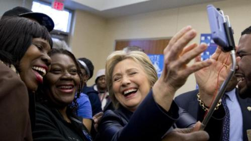 Democratic presidential candidate Hillary Clinton lags as she poses for photos with supporters after speaking at the the O'Fallon Park Recreation Complex in St. Louis, Saturday, March 12, 2016. (AP Photo/Carolyn Kaster)