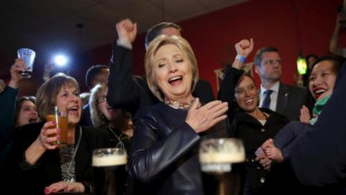 Democratic U.S. Presidential candidate Hillary Clinton reacts as she visit a local bar during a campaign stop in Youngstown, Ohio, March 12, 2016. REUTERS/Carlos Barria