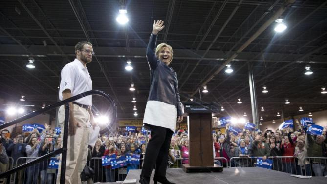 Democratic presidential candidate Hillary Clinton arrives with student Nathan Garrett at a campaign event at the Nelson-Mulligan Carpenters' Training Center in St. Louis, Saturday, March 12, 2016. (AP Photo/Carolyn Kaster)