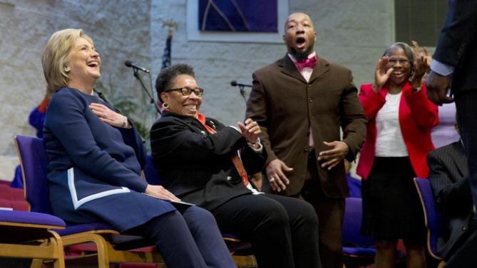 Democratic presidential candidate Hillary Clinton, left, sits with U.S. Rep. Marcia Fudge, D-Ohio, during service at Mount Zion Fellowship Church in Highland Hills, Ohio, Sunday, March 13, 2016. (AP Photo/Carolyn Kaster)