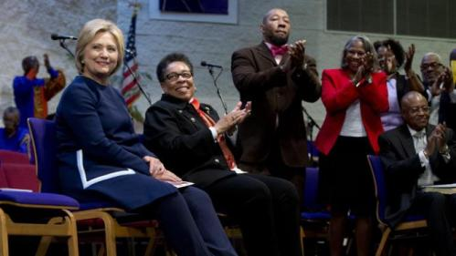 Democratic presidential candidate Hillary Clinton, left, is acknowledged as she sits with U.S. Rep. Marcia Fudge, D-Ohio, during service at Mount Zion Fellowship Church in Highland Hills, Ohio, Sunday, March 13, 2016. (AP Photo/Carolyn Kaster)