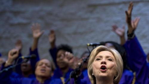 Democratic presidential candidate Hillary Clinton sings during service at Mount Zion Fellowship Church in Highland Hills, Ohio, Sunday, March 13, 2016. (AP Photo/Carolyn Kaster)