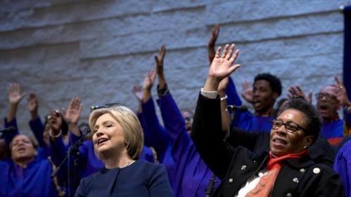 Democratic presidential candidate Hillary Clinton, joined by U.S. Rep. Marcia Fudge, D-Ohio, right, sings during service at Mount Zion Fellowship Church in Highland Hills, Ohio, Sunday, March 13, 2016. (AP Photo/Carolyn Kaster)