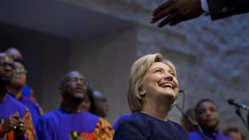 Democratic presidential candidate Hillary Clinton looks to Senior Pastor Clifton Ronald St. Clair Williams during service at Mount Zion Fellowship Church in Highland Hills, Ohio, Sunday, March 13, 2016. (AP Photo/Carolyn Kaster)