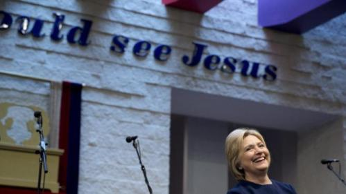 Democratic presidential candidate Hillary Clinton attends service at Mount Zion Fellowship Church in Highland Hills, Ohio, Sunday, March 13, 2016. (AP Photo/Carolyn Kaster)