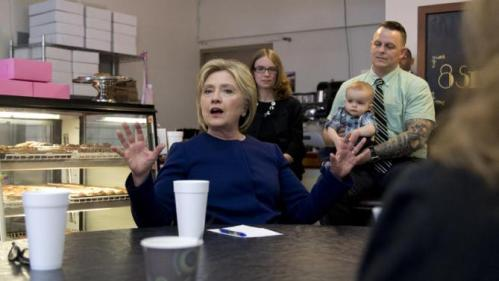 Democratic presidential candidate Hillary Clinton talks to a small group during a campaign stop at 8 Sisters Bakery in Marion, Ohio, Sunday, March 13, 2016. (AP Photo/Carolyn Kaster)