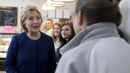 Democratic presidential candidate Hillary Clinton greets people as she arrives for a campaign visit at 8 Sisters Bakery in Marion, Ohio, Sunday, March 13, 2016. (AP Photo/Carolyn Kaster)