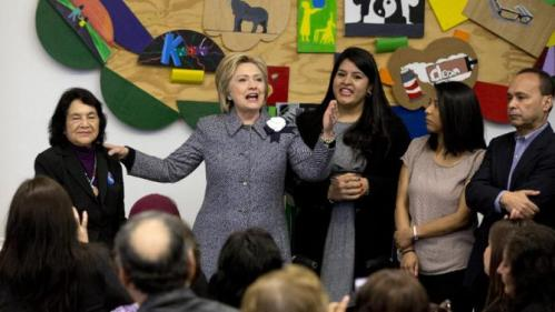 Democratic presidential candidate Hillary Clinton speaks during an immigration round table at The Resurrection Project at La Casa in the Pilsen neighborhood of Chicago, Monday, March 14, 2016. With Clinton at left is labor leader Dolores Huerta and far right is Rep. Luis Gutierrez, D-Ill. (AP Photo/Carolyn Kaster)