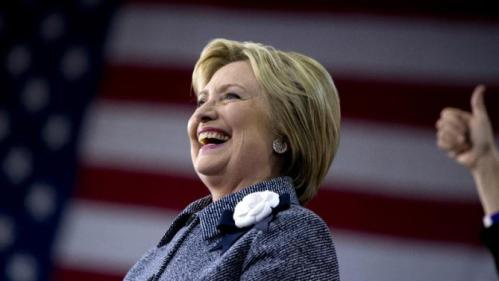 Democratic presidential candidate Hillary Clinton smiles as she is introduced on stage during a campaign event at the Grady Cole Center in Charlotte, N.C., Monday, March 14, 2016. (AP Photo/Carolyn Kaster)