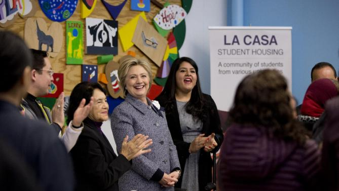 Democratic presidential candidate Hillary Clinton is applauded during an immigration round table at The Resurrection Project at La Casa in the Pilsen neighborhood of Chicago, Monday, March 14, 2016. With Clinton at left is labor leader Dolores Huerta. (AP Photo/Carolyn Kaster)