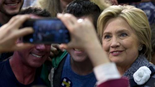 Democratic presidential candidate Hillary Clinton greets supporters and takes photos during a campaign event at the Grady Cole Center in Charlotte, N.C., Monday, March 14, 2016. (AP Photo/Carolyn Kaster)