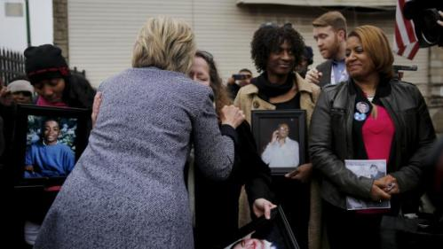 Democratic U.S. Presidential candidate Hillary Clinton meets with the mothers of victims of gun violence at a memorial called 'Kids of the Block' at Roseland neighborhood in Chicago, Illinois March 14, 2016. REUTERS/Carlos Barria