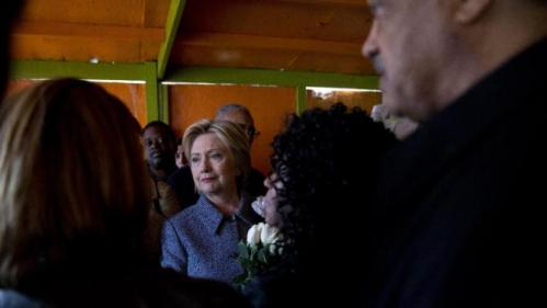 Democratic presidential candidate Hillary Clinton, joined by Rev. Jesse Jackson, right, and Diane Latiker of Kids off the Block memorial, second from right, visits the memorial to children killed by gun violence in Chicago, Monday, March 14, 2016. (AP Photo/Carolyn Kaster)