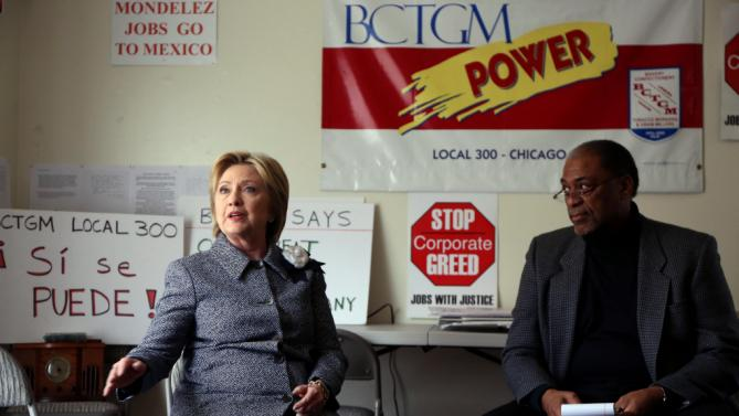 Democratic presidential candidate Hillary Clinton meets Monday, March 14, 2016, with Jethro Head, right, International Vice President of the Bakery, Confectionery, Tobacco Workers and Grain Millers International Union, who represents workers at the Chicago Nabisco factory which is threatened with closure. (Nancy Stone/Chicago Tribune via AP)
