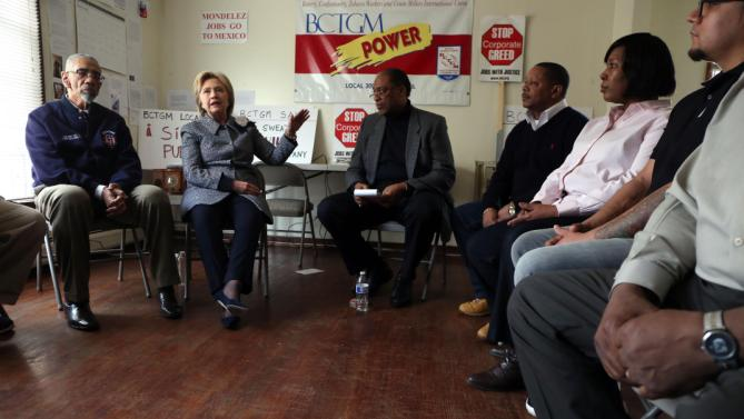 Democratic presidential candidate Hillary Clinton meets Monday, March 14, 2016, with U.S. Rep. Bobby Rush, left, and Jethro Head, right, International Vice President of the Bakery, Confectionery, Tobacco Workers and Grain Millers International Union, who represents workers at the Chicago Nabisco factory which is threatened with closure. (Nancy Stone/Chicago Tribune via AP)