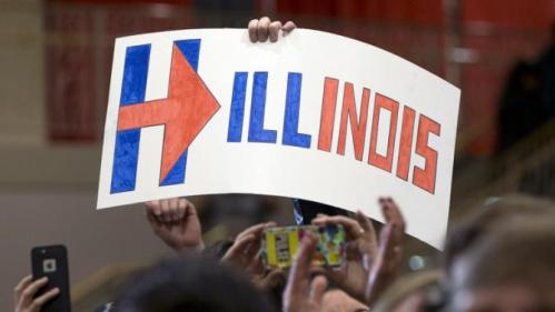 """Supporters hold up a sign that reads """"Hillinois"""" as Democratic presidential candidate Hillary Clinton speaks during a campaign event at Chicago Journeymen Local Plumbers Union in Chicago, Monday, March 14, 2016. (AP Photo/Carolyn Kaster)"""
