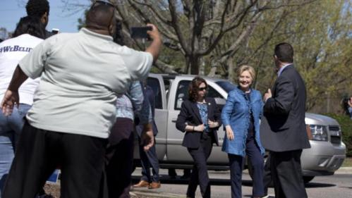 Democratic presidential candidate Hillary Clinton arrives to visit a polling place a Southeast Raleigh Magnet High School in Raleigh, N.C., Tuesday, March 15, 2016. (AP Photo/Carolyn Kaster)