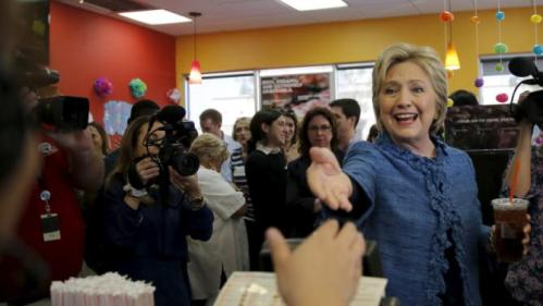 Democratic U.S. Presidential candidate Hillary Clinton shakes hands with employees at a Dunkin' Donuts coffee shop during a campaign stop in West Palm Beach, Florida March 15, 2016. REUTERS/Carlos Barria