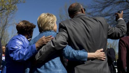 Democratic presidential candidate Hillary Clinton greets people as she visits a polling place a Southeast Raleigh Magnet High School in Raleigh, N.C., Tuesday, March 15, 2016. (AP Photo/Carolyn Kaster)