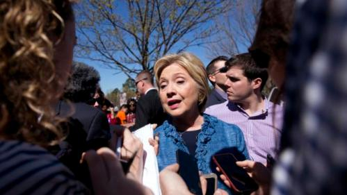 Democratic presidential candidate Hillary Clinton talks to media as during a visits to a polling place a Southeast Raleigh Magnet High School in Raleigh, N.C., Tuesday, March 15, 2016. (AP Photo/Carolyn Kaster)