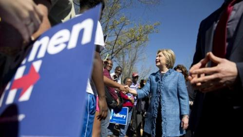Democratic presidential candidate Hillary Clinton visits a polling place a Southeast Raleigh Magnet High School in Raleigh, N.C., Tuesday, March 15, 2016. (AP Photo/Carolyn Kaster)