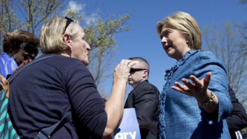 Democratic presidential candidate Hillary Clinton talks with a woman as she greets people at a polling place at Southeast Raleigh Magnet High School in Raleigh, N.C., Tuesday, March 15, 2016. Clinton faces Democratic rival Bernie Sanders in primary contests in five states on Tuesday: North Carolina, Florida, Ohio, Missouri and Illinois. (AP Photo/Carolyn Kaster)